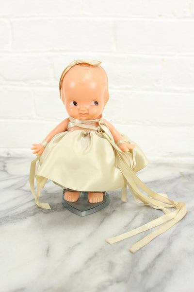 Irwin Kewpie Style Celluloid Baby Doll with Dress and Bow on Base, 6""