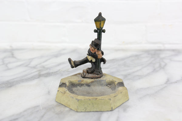 Die Cast Metal Ashtray with Drunk Man Hanging on Lamp Post, John Wright