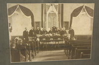Matted Funeral Photograph of a Casket in a Church Surrounded by Mourners