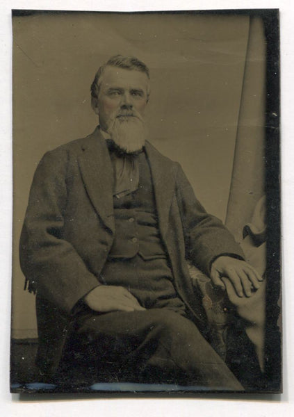 Tintype Photograph of a Bearded Man in a Chair