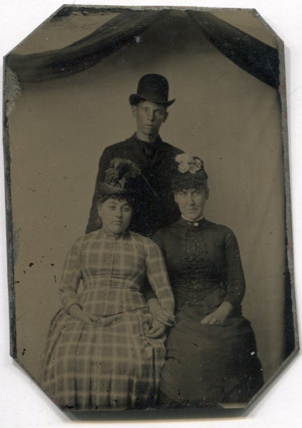 Tintype Photograph of a Man in a Bowler Hat with Two Ladies