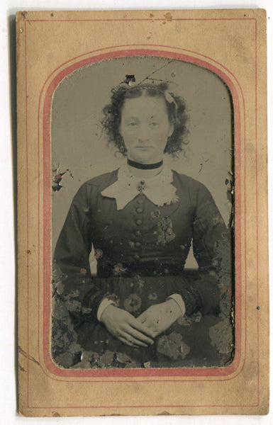 Tintype Photograph of a Woman with Crossed Hands in Paper Frame