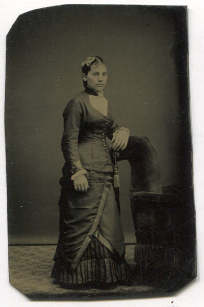 Tintype Photograph of a Young Woman Leaning On a Chair