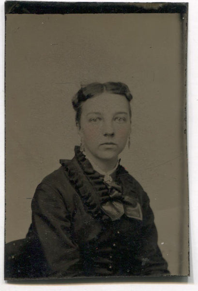 Tintype Photograph of a Woman with a Ruffled Collar and Dangly Earrings