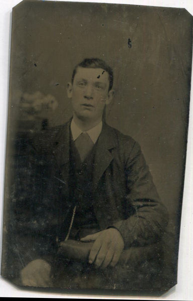 Tintype Photograph of a Man with Huge Hands
