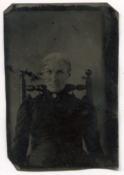 Tintype of an Older Woman in a Wooden Chair Dressed in Mourning Clothes