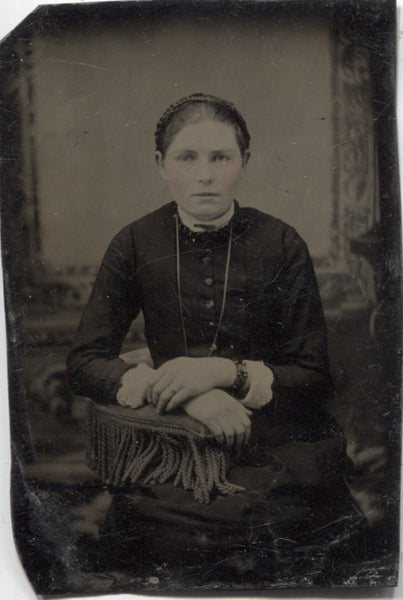 Tintype Photograph of a Young Woman with Crossed Hands