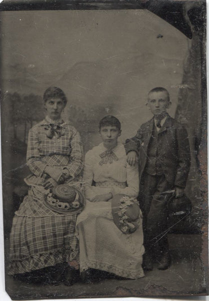 Tintype Photograph of Three Siblings, Two Sisters and a Brother
