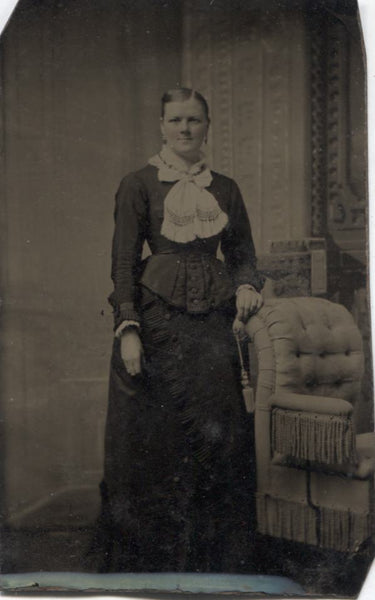 Tintype Photograph of a Woman Standing Next to a Chair