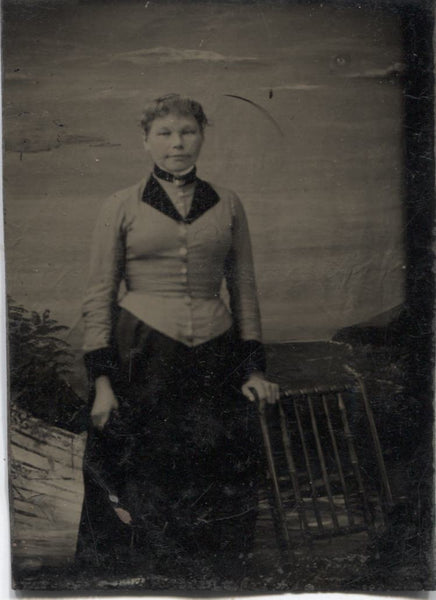 Tintype Photograph of a Standing Woman Next to a Chair
