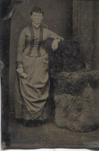 Tintype Photograph of a Woman Standing Next to a Wool Chair