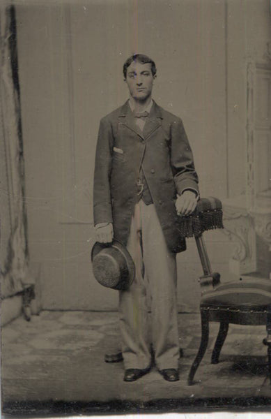 Tintype Photograph of a Standing Man with a Hat in His Hand
