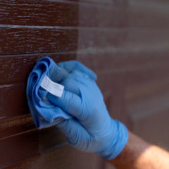 The best way to clean garage doors is to use AL-NEW aluminum restoration solution with a microfiber cloth.