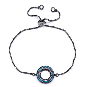 Circle and zircon bracelet with adjustable chain.
