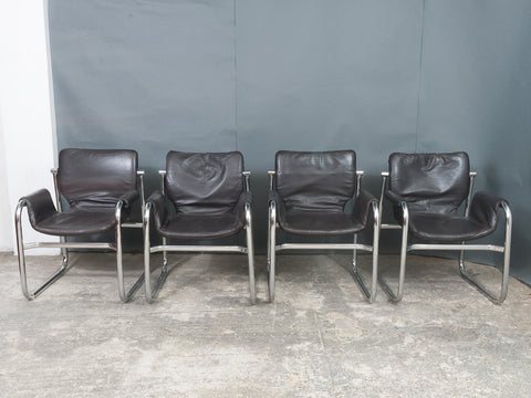 Four Post-Modern Tubular Chrome Faux-Leather Sling Arm Cantilever Armchairs