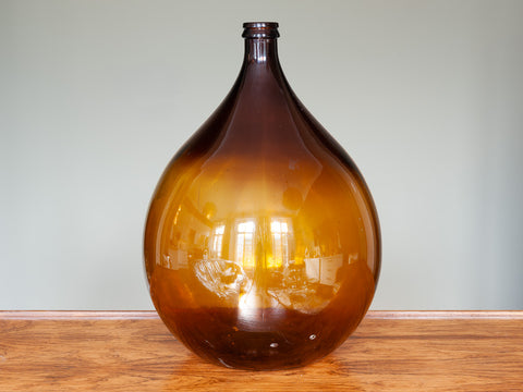 LARGE VINTAGE FRENCH AMBER GLASS DEMIJOHN
