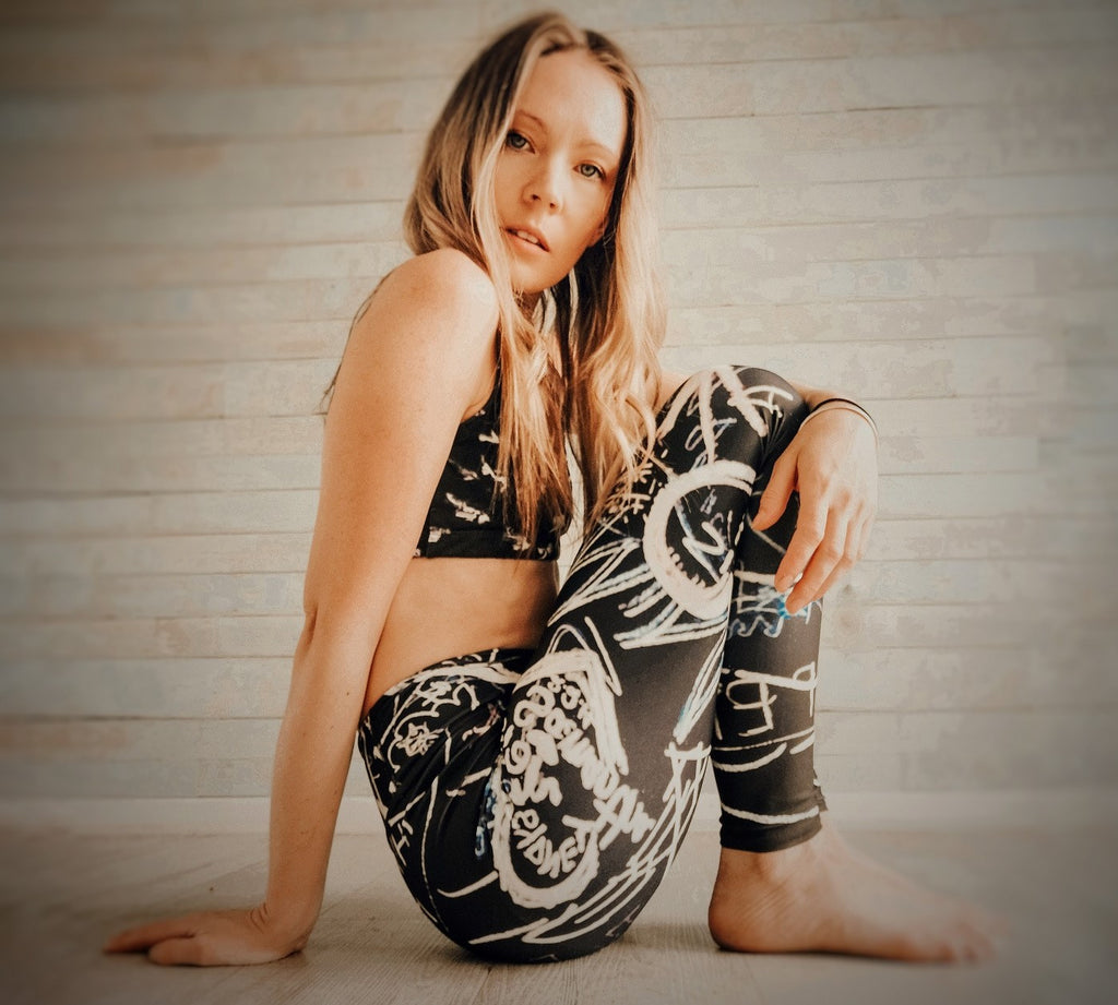 woman wearing black graffiti leggings