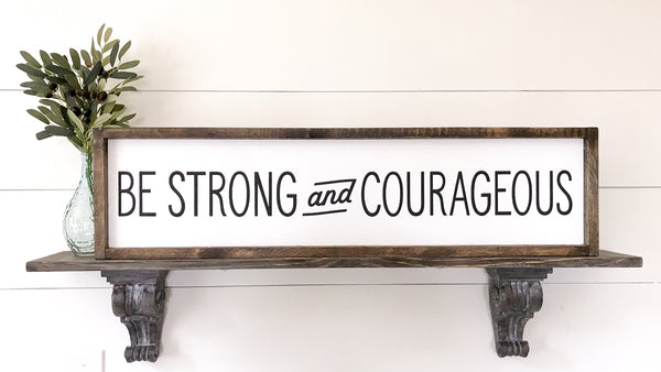 Farmhouse framed sign with Be Strong and Courageous from Joshua 1:6.