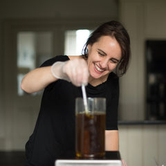 Photo of Amaranthine Founder, Sarah, making face oil.
