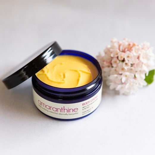 Amaranthine Body Crème body butter, open, showing the product inside.