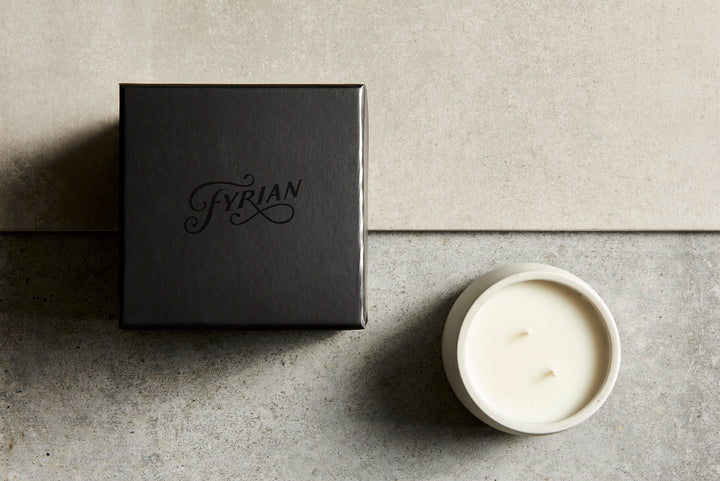 candle and packaging image, top down, matte black, concrete