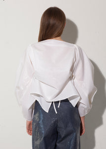 'RECIPROCAL, IMPROVISED AND INTENSE' BLOUSE