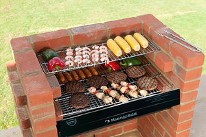 Black Knight BKB 402 brick bbq deluxe kit being used to barbecue meat, fish and veg.