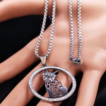 Silver Colored French Bulldog Crystal Stainless Steel Women's Necklace Resting On The Palm Of A Hand