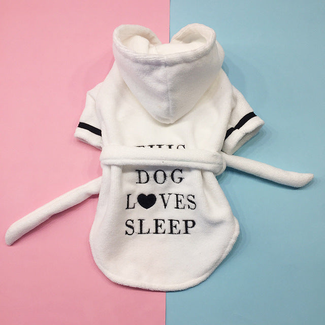 French Bulldog Hooded Bathrobe Towel With The Words 'This Dog Loves Sleep' Written On It on a half baby pink and half baby blue backgroundand