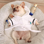French Bulldog Sleeping In A Round Dog Bed Wearing A Hooded Bathrobe Towel