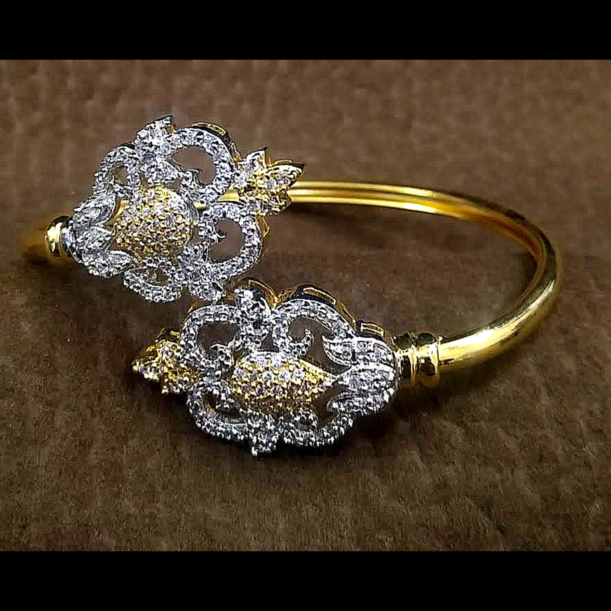 Golden Bracelet with Zercon Silver Work