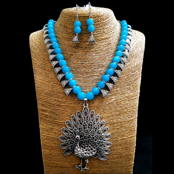 Green Antique Moti Mala with heavy silver Peacock Pendant Necklace Set