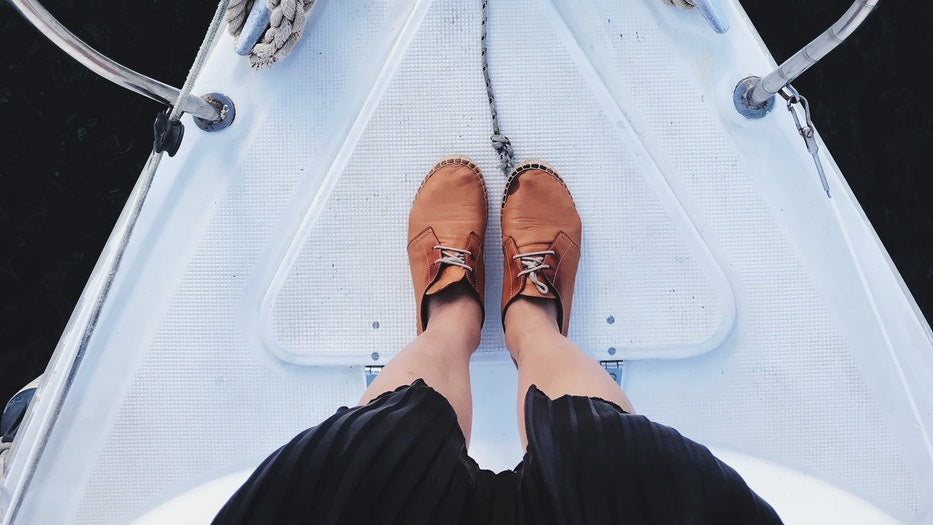 5 Properties of a Quality Boating Shoe: Deck Shoes Made Easy! shoes on the bow