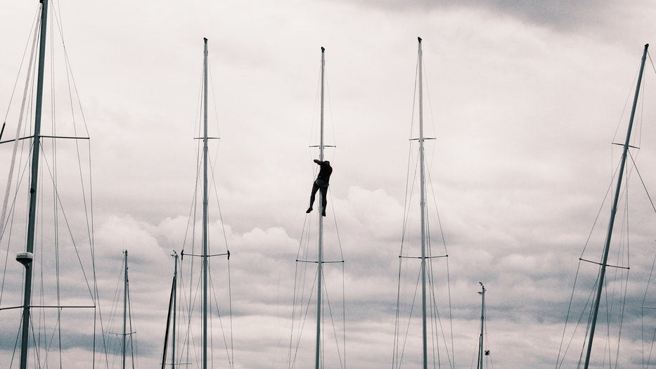 Climbing The Mast Quickly and Safely man climbs