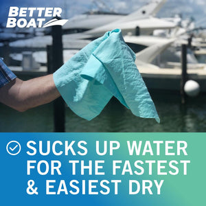 Synthetic Chamois Dry Towel in Hand at Marina With Boats