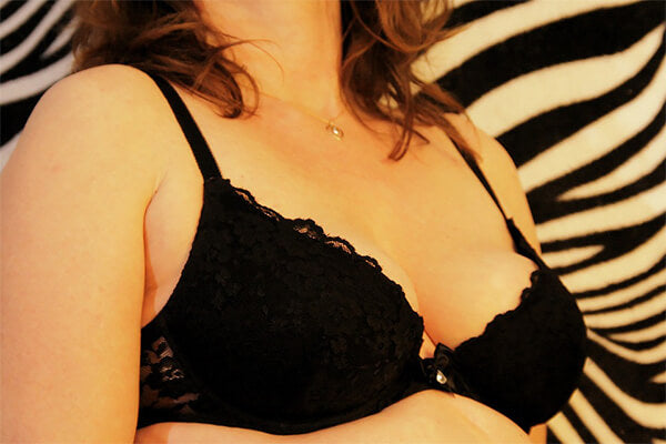 woman with large breasts wearing bra
