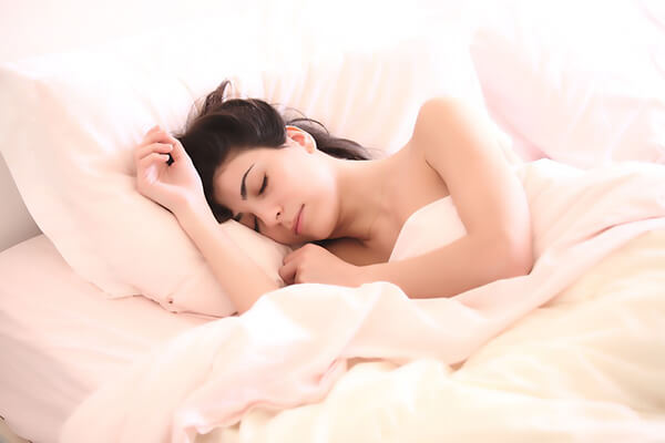 woman sleeping well on bed