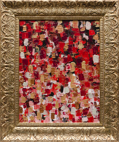 A red abstract painting with an ornate gold frame