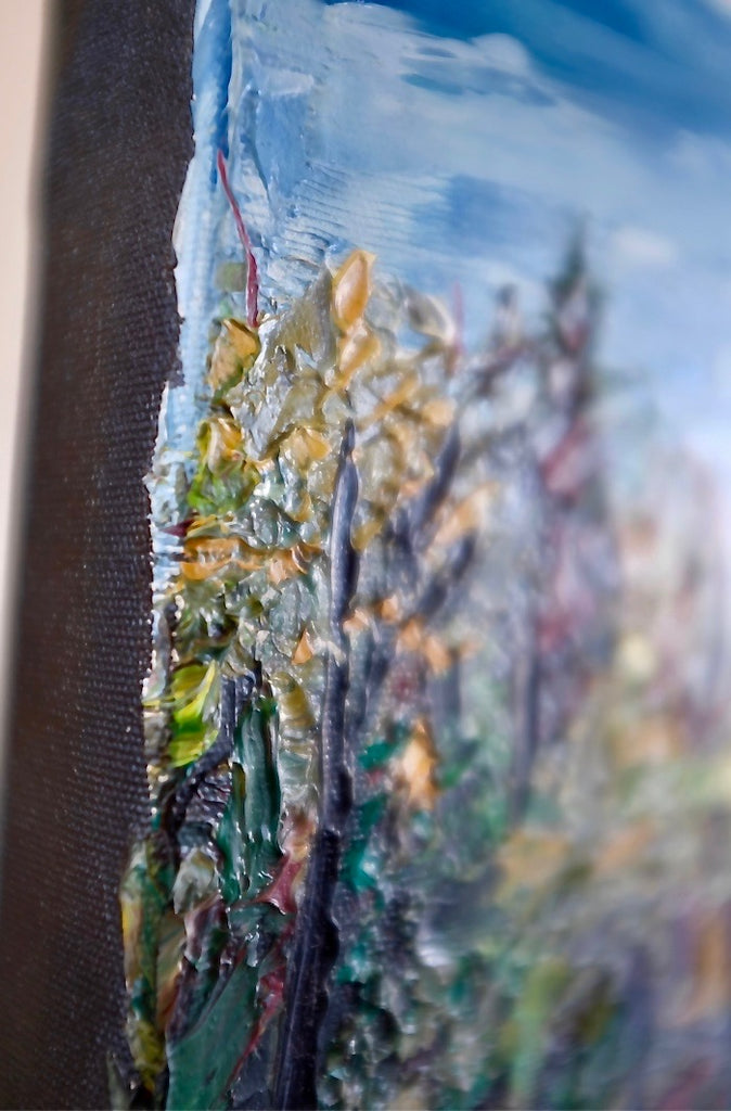 Side view of a textured painting