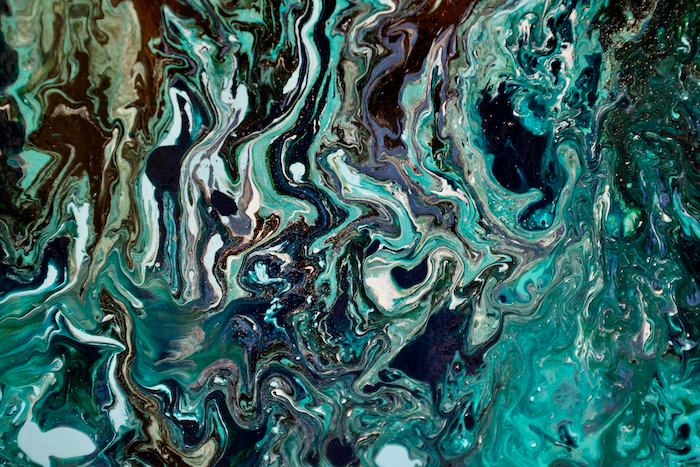 Pouring paint swirls teal