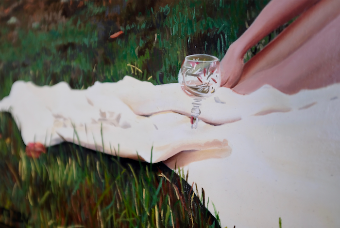Close up of a painting with a woman sitting drinking wine