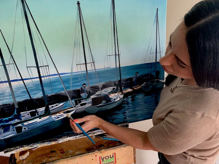 Artist Sarazen Brooks painting sailboats
