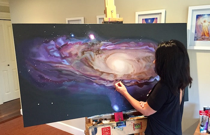 Artist Sarazen Brooks painting a spiral galaxy