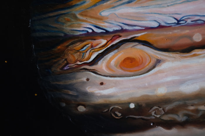 A close up of a painting of Jupiter