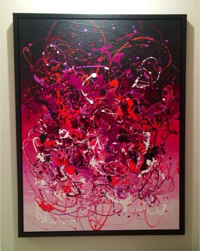 Large magenta abstract painting with pouring medium