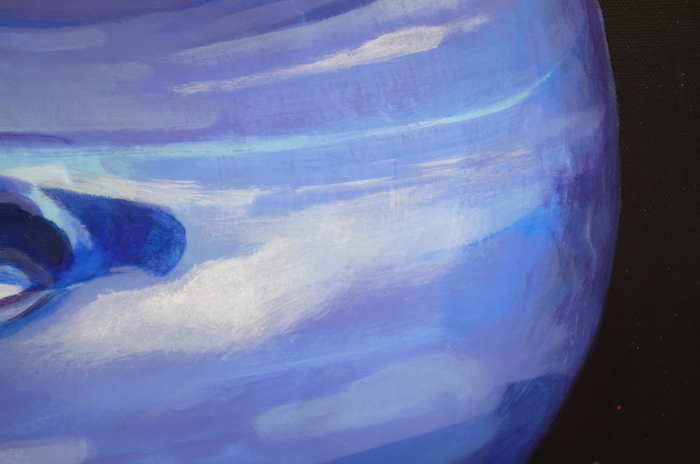 A close up of a painting of the planet Neptune