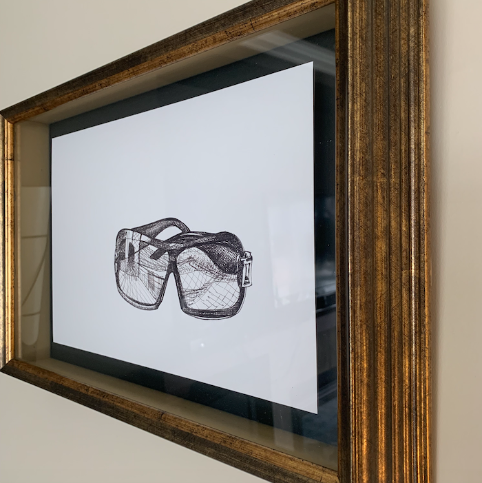 Framed pen and ink sketch of sunglasses