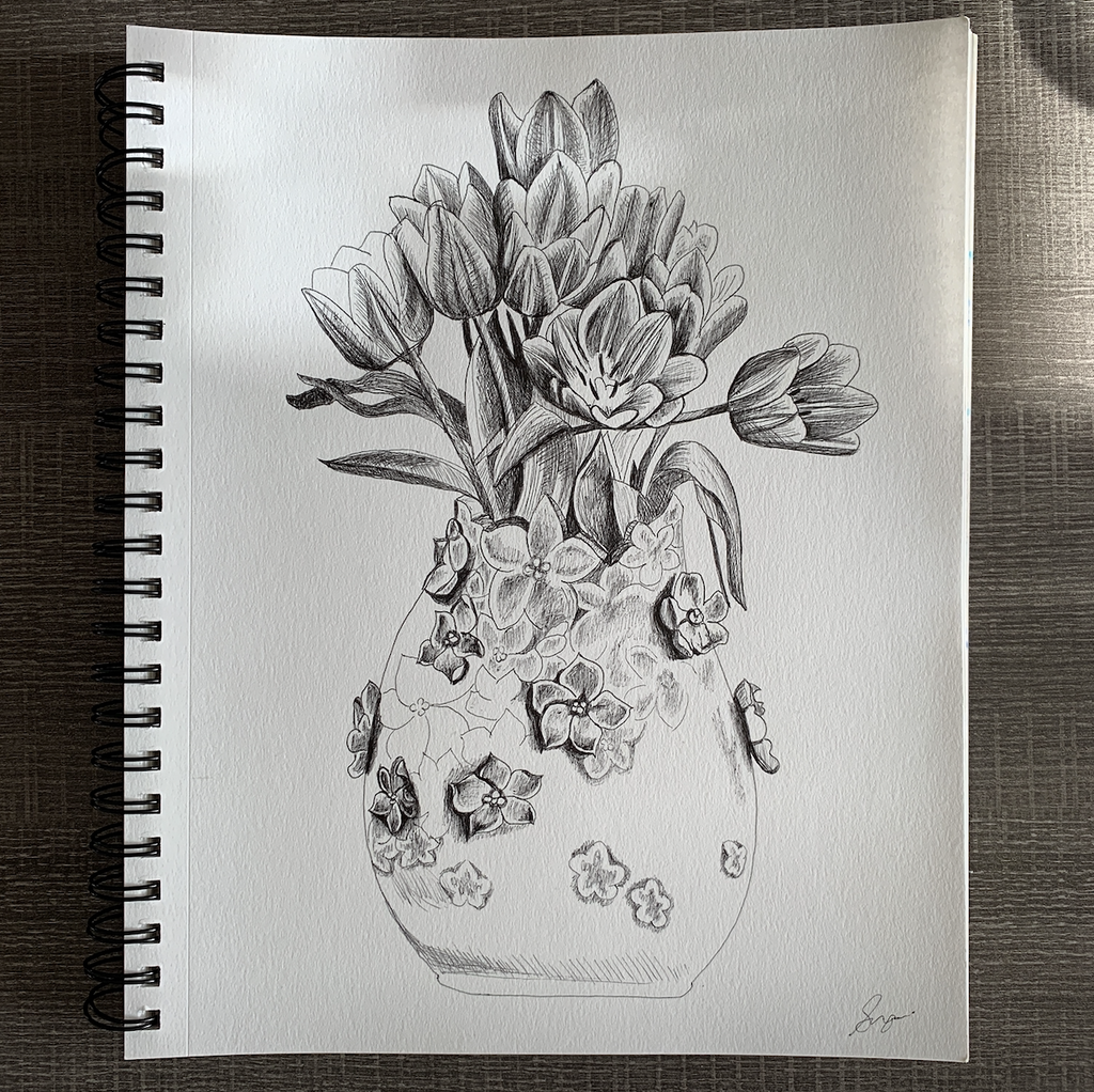 Pencil sketch of tulips in a flowered vase