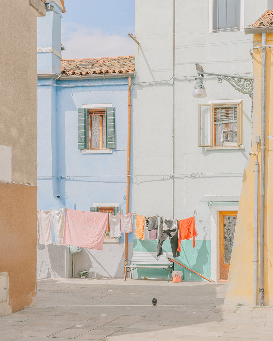 An image of some houses, with washing hanging outside, by emerging Portuguese photographer Teresa Freitas.