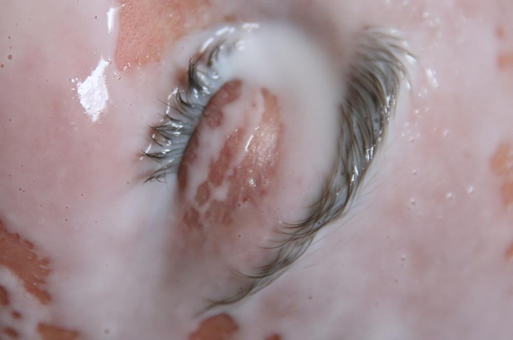An image of an eye and its surrounding area, covered in milk, by emerging Dutch artist Lana Prins.